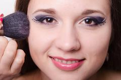 model is applied to the face powder - stock photo