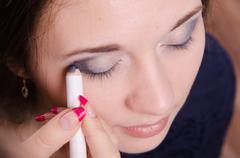 Makeup artist brush eyelash tints model Stock Photos