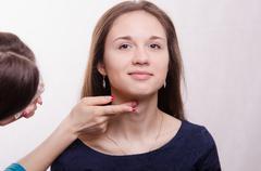 beautiful model makeup artist applied concealer on neck - stock photo