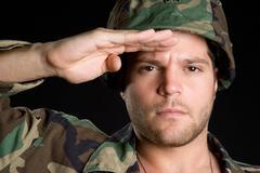 saluting man - stock photo