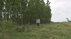 Young cute man walking through virgin forest nice walk for relaxing after work Stock Footage