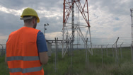 Stock Video Footage of Engineer going to energy power station working on laptop checking gathering info