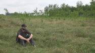 Stock Video Footage of Amazing way to relax man sitting alone in open field forest chilling looking joy
