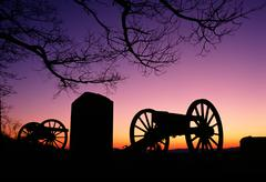 War memorial wheeled cannon military civil war weapon dusk sunset Stock Photos