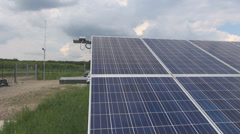 Solar panels grid equipment seen from the front side in a cloudy summer day Stock Footage