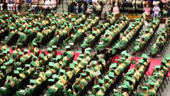 Graduation high school senior hat throw slowmo Stock Footage