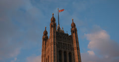 4K video of the Union Jack British flag on top of London's Parliament building Stock Footage
