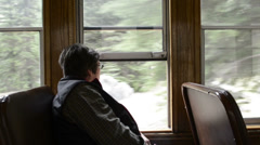 Female passenger watches the Rocky Mountain scenery pass by-HD-P-1967 Stock Footage