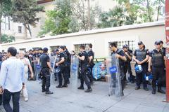 police in riot gear await orders during a protest - stock photo