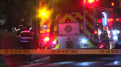 Fire line yellow tape firetrucks and firefighters at scene ZO Stock Footage