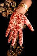 Beautiful Henna, Mehendi on the brides hand - stock photo