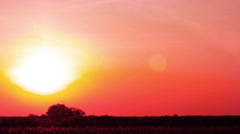 Subset in red color.   time lapse clip without birds, RAW Stock Footage