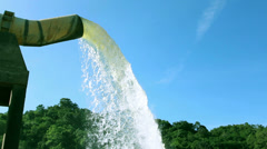 Water supply pipe and dam with blue sy background Stock Footage
