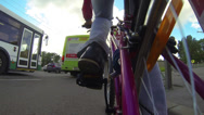 Stock Video Footage of Cyclist bypassing traffic jam on roadside