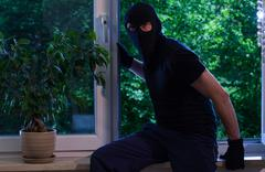 the thief broke into the apartment - stock photo
