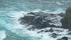 Wild waves crash over rocks Stock Footage