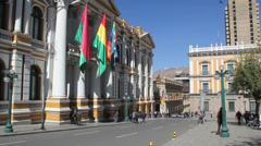La Paz flags at govenment palace c Stock Footage