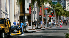 Tourists explore Rodeo Drive in Beverly Hills in Los Angeles California 4K Stock Footage