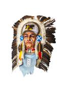 Wood carved indian chief head on white Stock Photos