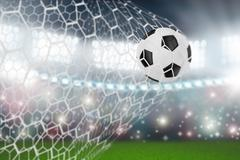 Soccer ball in goal net Stock Illustration
