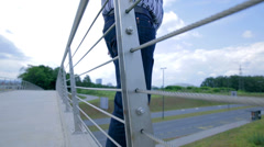 Businessman On The Edge of Bridge Doing Suicide Stock Footage