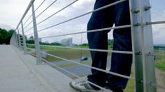 Depressed Man On Edge of Bridge Stock Footage