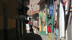 La Paz back street couple talking c Stock Footage
