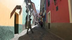 La Paz back street man leaves door c Stock Footage