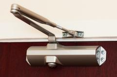 Automatic hydraulic leaver hinge door closer holder Stock Photos