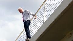 Businessman Doing Suicide From Bridge Stock Footage