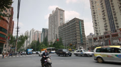 Shanghai car traffic with high rise condominiums - stock footage