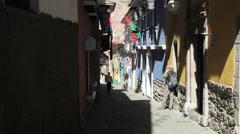 Bolivia La Paz back street tourist takes photo  Stock Footage