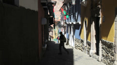 La Paz back street Tourist walks up street Stock Footage