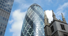 4K video of 30 St Mary Axe, with St Andrew Undershaft church in the foreground Stock Footage