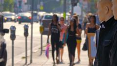 Anonymous crowd of people walking on Melrose Avenue in Los Angeles, California. Stock Footage