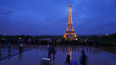 France, Paris, tourists make photo under rain against Eiffel tower, time-lapse. Stock Footage