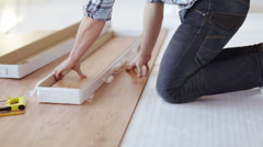 Close up of male hands measuring wood flooring Stock Footage