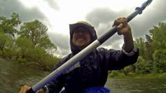 Man on kayak in the rain Stock Footage
