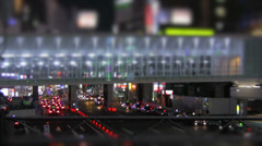 Time lapse of pedestrians walking across an elevated walkway in , Tokyo - stock footage