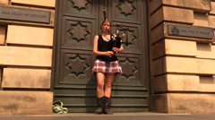Girl playing bagpipe (audio) Stock Footage