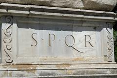 rome, roman spqr inscription of the roman empire on marble - stock photo