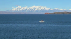 Bolivia Lake Titicaca & Andes with boat  Stock Footage