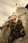 Beautiful woman soldier with a sniper rifle Stock Photos