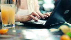 Female hands typing on laptop in cafe HD Stock Footage