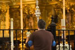 Virgin of el rocio devout praying Stock Photos
