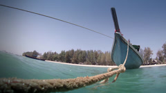 Thai boat tied with rope at Khao Lak sea side - Thailand Stock Footage