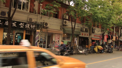 Street life with traffic in Shanghai Former French Concession Stock Footage