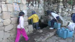 Children at a fountain on Bolivia Island of Sun s Stock Footage
