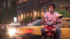 Asian Biker with Face Mask Stock Footage