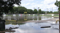 Flooded parking lot with gate Stock Footage